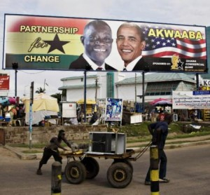 Barack Obama appears on campaign billboards with John Atta Mills